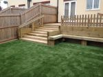 Timber Steps down to new artificial lawn